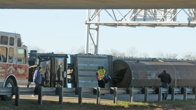 A semitrailer hauling a heavy load rolled over while going eastbound on U.S. Interstate 70 under the U.S. Interstate 135 bridge at 9:47 a.m. on Monday morning. There were no injuries reported. [AARON ANDERS/SALINA JOURNAL]