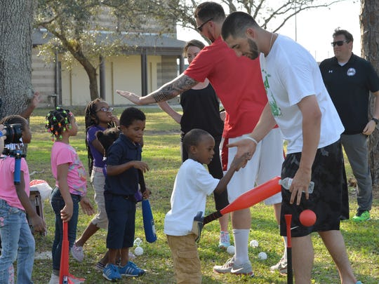 Red Sox Pitchers Anthony Ranaudo and Brandon Workman with youth from Child Care of Southwest Florida, Inc.
