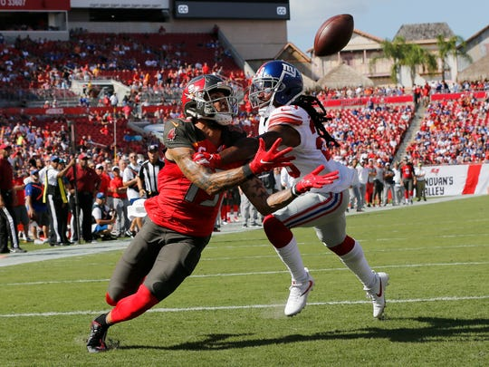 Tampa Bay Buccaneers wide receiver Mike Evans (13) beats New York Giants cornerback Janoris Jenkins on a 21-yard touchdown pass during the first half of an NFL football game Sunday, Sept. 22, 2019, in Tampa, Fla. (AP Photo/Mark LoMoglio)