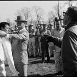 """Curtis, left, and Wynn rehearsed a scene from the movie, """"The Great Race,"""" where Curtis dangles by his feet from a hot air balloon gondola. A scene in the movie that was filmed in Frankfort, Ky."""
