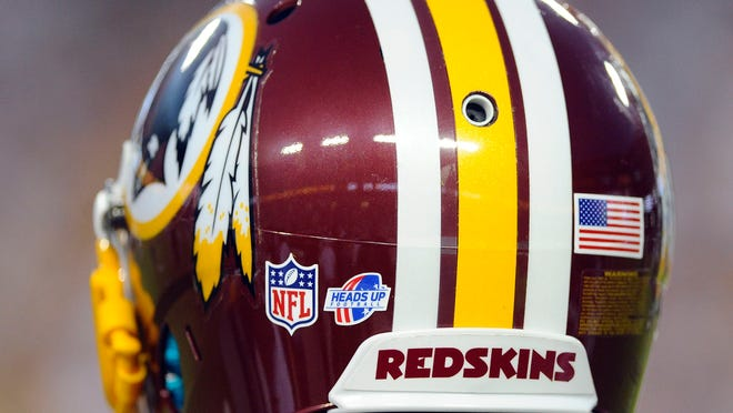 Aug 19, 2013; Landover, MD, USA; Washington Redskins cornerback E.J. Biggers (30) is shown with the NFL heads up logo on his helmet before the game against the Pittsburgh Steelers at FedEX Field. Mandatory Credit: Brad Mills-USA TODAY Sports