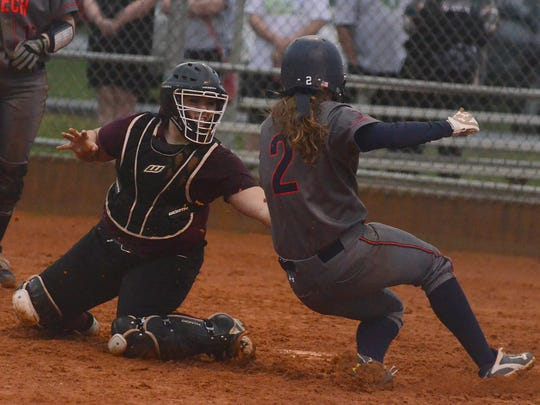 Station Camp High senior catcher Chasity Wheeley tags