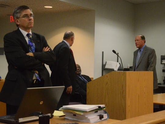 Prosecutor David Gilbert waits for court to begin and