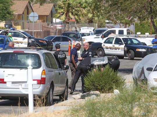 Police investigate the scene near where gunshots were fired on 4th Street in Desert Hot Springs, July 12, 2017.