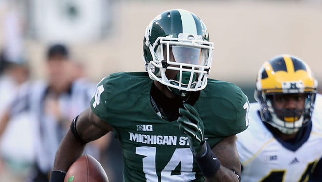 Michigan State WR Tony Lippett runs for a touchdown during Saturday win over U-M in East Lansing.