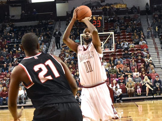 New Mexico State's Johnathon Wilkins takes a jump shot from the free throw line as the Aggies beat the Seattle University Redhawks Saturday night at the Pan American Center.