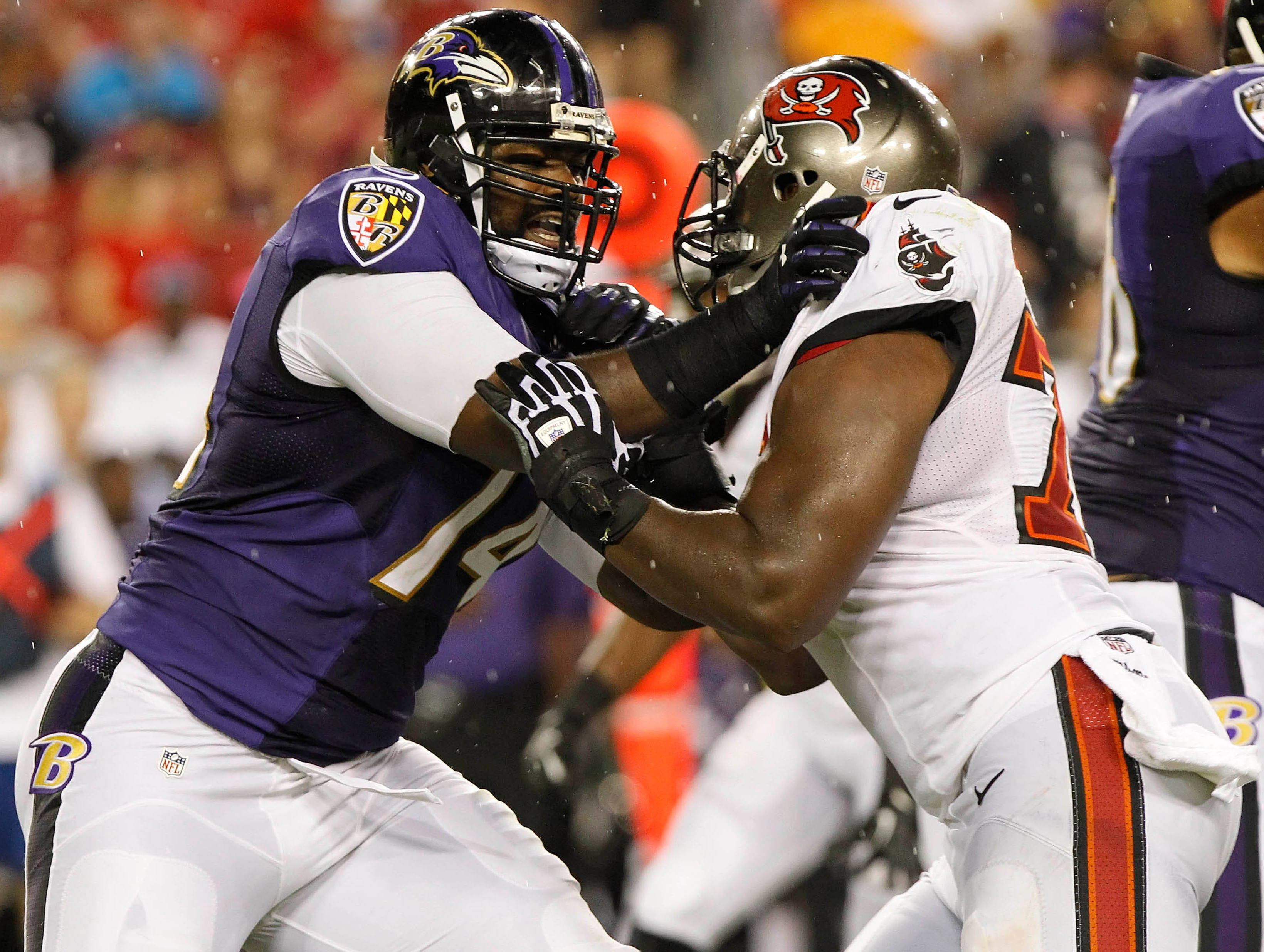Baltimore Ravens tackle Michael Oher (74) blocks Tampa Bay Buccaneers defensive end Lazarius Levingston (78) during the second quarter at Raymond James Stadium.