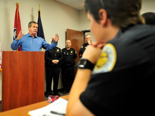 Mayor Karl Dean, left, speaks to police officers during the first roll call at the Midtown Hills Precinct, which opens to the public today.