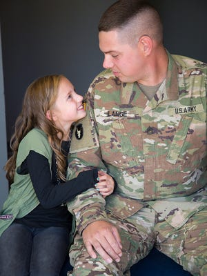 Mikayla Lang and her father Sgt. First Class Robert Lange, both of Ankeny, Ia.