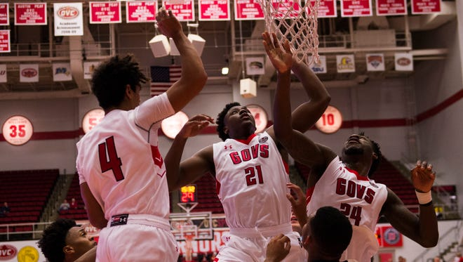Austin Peay's Terry Taylor (21) and Averyl Ugba (24) go up for the rebound against Oakland City on Nov. 15.