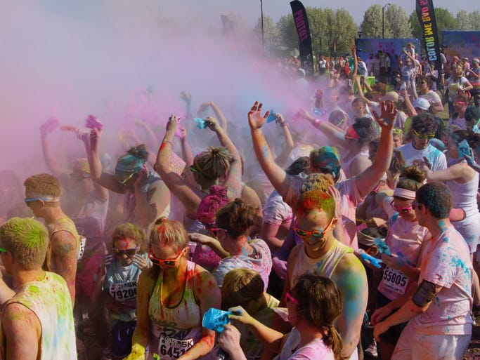 Runners celebrating at the end of the 2014 Color Me Rad Run.