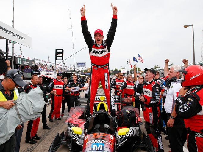 Sebastien Bourdais, of France, celebrates winning race