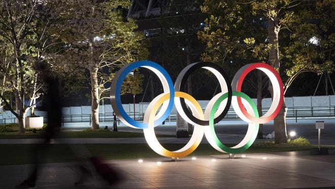 The Olympic rings are seen Monday, March 30, in Tokyo. The Tokyo Olympics will open next year in the same time slot scheduled for this year's games.
