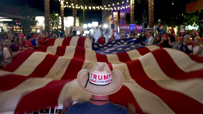 President Trump supporters wave a flag during an election watch party Nov. 3 in Chandler, Ariz.
