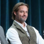 Actors Josh Holloway and Sarah Wayne Callies speak onstage during the USA Networks? 'Colony' panel discussion at the NBCUniversal portion of the 2015 Summer TCA Tour at The Beverly Hilton Hotel.