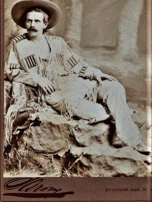 A studio shot shows marksman Doc Carver in buckskins.
