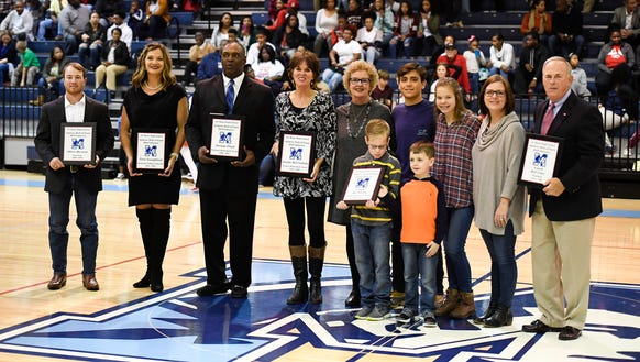J.L. Mann High School Athletic Hall of Fame inductees Oliver Burman, Norman Floyd, Tara Youngblood Easler, Bill Utsey, Jennifer Mills Grabosky and the family of Joe Watson Sr. stand with their plaques Friday night during the induction ceremony. JOSH MORGAN/Staff