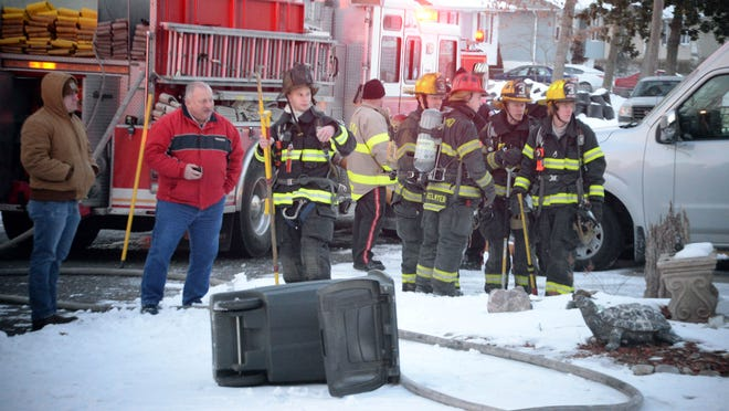 Vineland firefighters stand by after extinguishing a blaze in the 300 block of Doren Terrace on Friday.