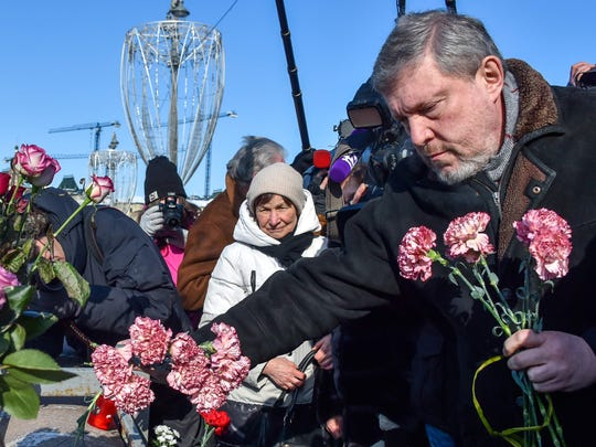 Russian presidential candidate Grigory Yavlinsky lays