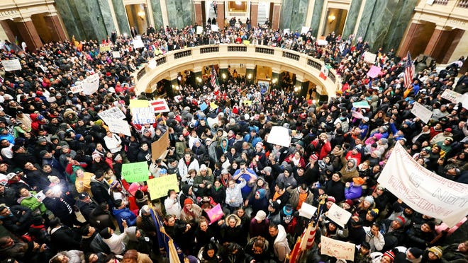 Thousands of Latinos, immigrants and their supporters rallied in February inside the Capitol in Madison to protest legislative bills they believed to be anti-immigration.