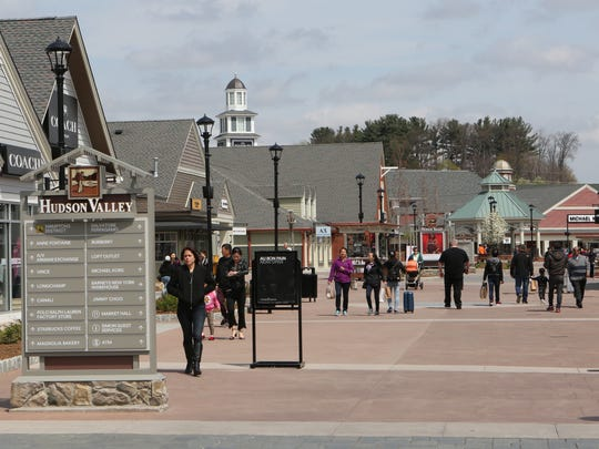 Shoppers fill the plaza at Woodbury Common in Central Valley in this file photo.