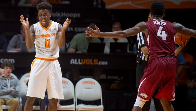 Tennessee's Jordan Bone, left, celebrates a call as Arkansas' Daryl Macon argues during the second half on Jan. 3 at Thompson-Boling Arena.