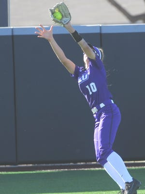 ACU left fielder Caroline Adair snags a fly ball by Baylor's Maddison Kettler for the first out in the top of the fifth inning. No. 8 Baylor (9-0) won the game 13-2 in five innings, after winning the opener 3-0 Sunday, Feb. 25, 2018 at Poly Wells Field.