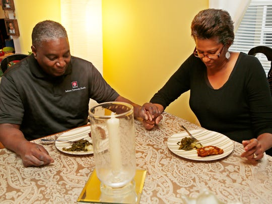 Pastor Dale Draper and his wife Starla join hands in prayer before enjoying their eveing meal Tuesday, November 17, 2015, in their Lafayette home. Pastor Draper works from August to November to create a Thanksgiving dinner for the homeless that has all the flair and elegance of a meal fit for a family.