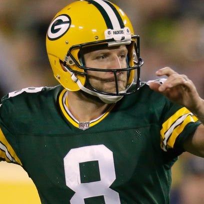 Green Bay Packers quarterback Taysom Hill (8) scrambles