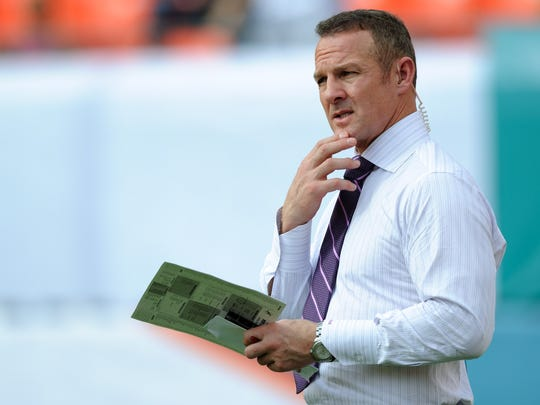 Dec 15, 2013; Miami Gardens, FL, ESPN  analyst Merril Hoge looks on before a game against between the New England Patriots and the Miami Dolphins at Sun Life Stadium. The Dolphins won 24-20. Mandatory Credit: Steve Mitchell-USA TODAY Sports usp ORG XMIT: USATSI-132990 [Via MerlinFTP Drop]