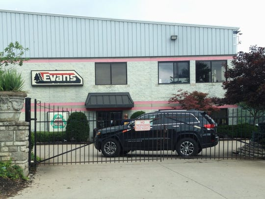Investigators searched the premises of Evans Landscaping in Newtown in July 2015