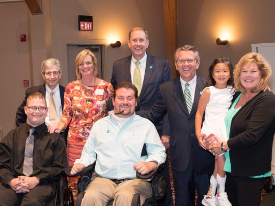 """Changing lives Easterseals honored Wayne, Jill, Ben and Josh Trockman with a Changing Lives Award at its annual Tribute Dinner. The Trockmans have championed the organization's mission for more than 10 years as advocates, volunteers and benefactors. They were instrumental to the success of the """"Ensure the Future"""" capital campaign to fund renovations at the Easterseals' Rehabilitation Center. Pictured at Tribute are back row from left, Wayne Trockman, Easterseals President Kelly Schneider, Old National Bank President and Chief Operating Officer Jim Sandgren, Evansville Mayor Lloyd Winnecke, 2017 Easterseals Child Ambassador Miah Dillingham and Jill Trockman.  In the front row are 2017 Easterseals Adult Ambassador Andy Imlay and Ben Trockman."""