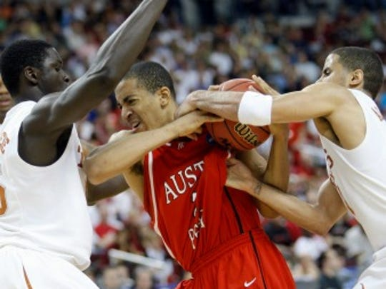 Austin Peay forward Drake Reed, center, fights to keep