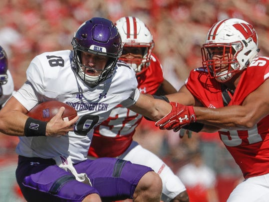 Wisconsin's Alec James sacks Northwestern's Clayton Thorson during the second half of an NCAA college football game Saturday, Sept. 30, 2017, in Madison, Wis. Wisconsin won 33-24. (AP Photo/Morry Gash)