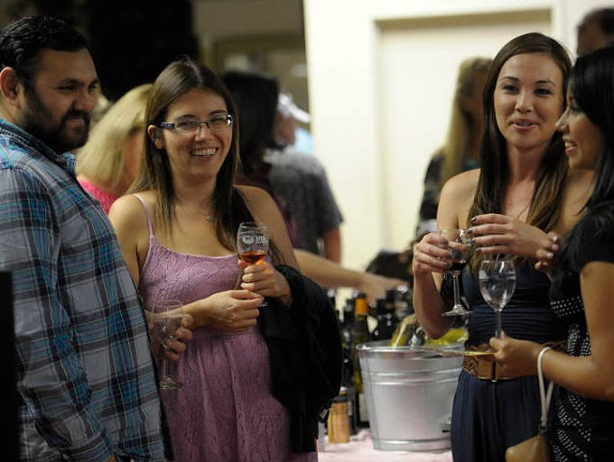 About a 1000 people drank and tasted what Downtown Visalia had to offer Tuesday night during the 20 year anniversary of Taste of Downtown Visalia. 31 businesses participated with food, and a beer and a wine tasting event.