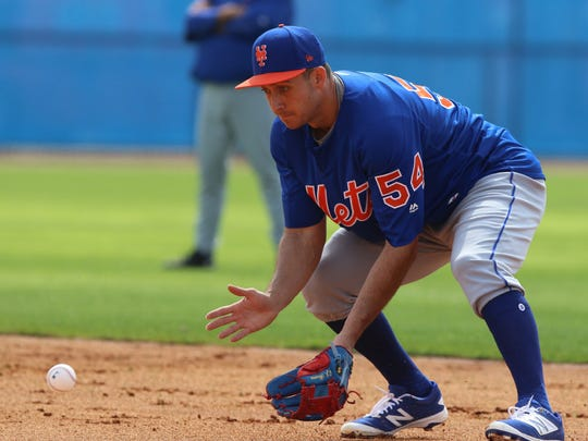 TJ Rivera fields a grounder during camp.