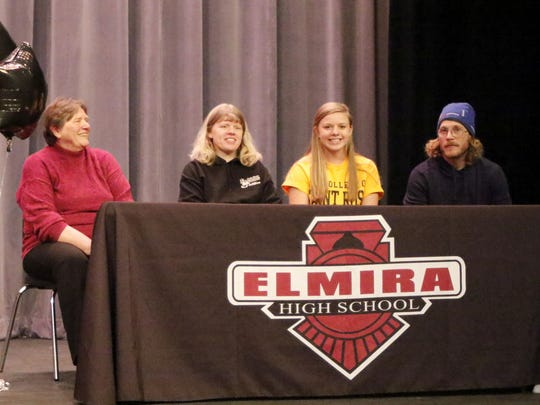 Alexus Boorse with her parents, Alice Wilson and Curtis Boorse, and her grandmother, MaryAnne Boorse, at Thursday's signing ceremony at Elmira High School.