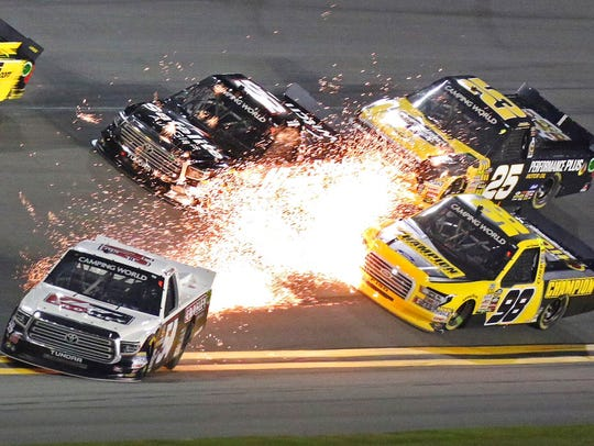 Sparks fly from the truck of driver Bo LeMastus (54)