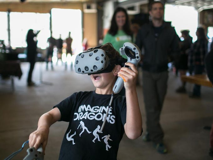 Fisher Armstrong; age 9, plays a VR game during the