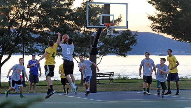 The summer basketball league plays during sunset at Scenic Hudson Park in Irvington on July 27.