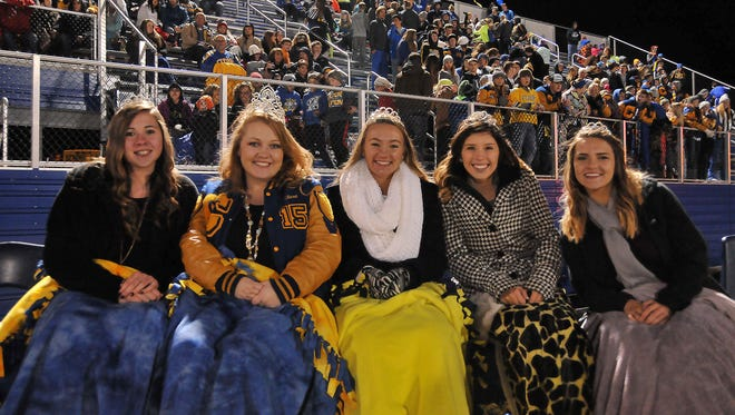 The Clyde High School 2015 Homecoming court was crowned before Friday's game verus Port Clinton and spent the game keeping warm under blankets and drinking hot chocolate. From left to right are: Freshman attendant Madison Jones; Queen Kyrah Cagle; Junior attendant Melissa Laconis; Senior attendant Alexandrea Montano; and Sophomore attendant Chloe Venturino.