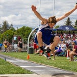 Fairfield junior Cantor Coverdell flies into the sandpit at the end of his triple jump during competition at the 2015 State track meet at Legends Stadium in Kalispell.