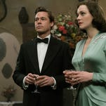 "This image released by Paramount Pictures shows Marion Cotillard, right, and Brad Pitt in a scene from, ""Allied,"" in theaters on November 23. (Daniel Smith/Paramount Pictures via AP) ORG XMIT: NYET948"
