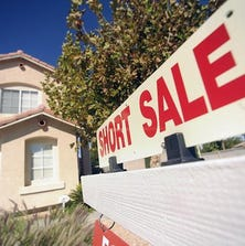 A short sale sign hangs outside a home for sale in Las Vegas.