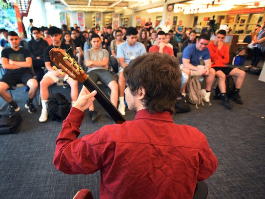 Ben Skwarek, 18, a self-taught guitarist whose talent is so well received by the students and staff, performs in front of the students at Becton High School in East Rutherford on June 13, 2018. He won first place this spring in the school talent show and at the International Day assembly, where his fellow students gave him a standing ovation.