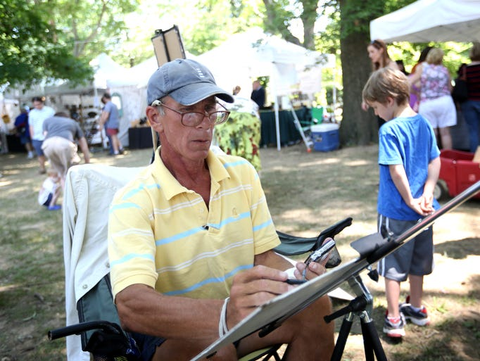 David Orman draws a portraits at the Crescent Hill Fourth of July Festival. July 5, 2014.