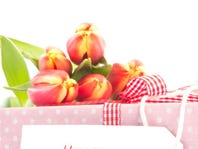 Bouquet of tulips on a gift with a happy mothers card