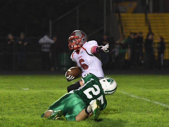 Margaretta's Collin Lane makes a tackle Friday against