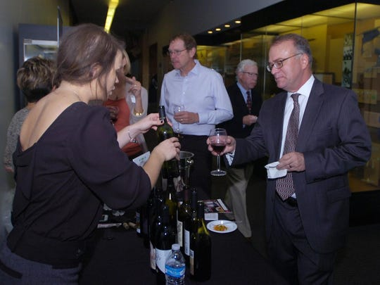 John Mucha of West Bloomfield samples some Michigan red wine.