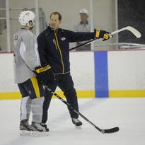 Predators assistant coach Phil Housley talks to defenseman Ryan Ellis during training camp in 2013. Sanford Myers / file / The Tennessean
